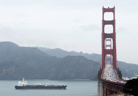 FILE PHOTO: An oil tanker passes underneath the Golden Gate Bridge in San Francisco, California, February 26, 2014. REUTERS/Beck Diefenbach/File Photo