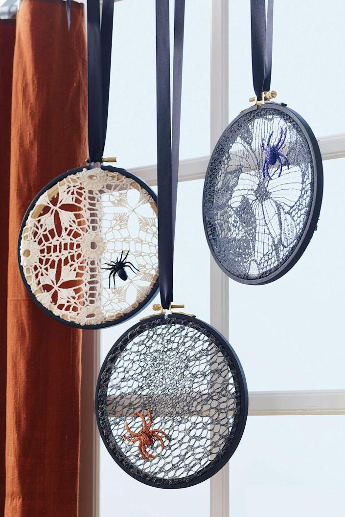 """<p>Add a spooky element to your house with this easy DIY decor.</p><p><strong><a href=""""https://www.womansday.com/home/crafts-projects/how-to/a5940/craft-project-lace-spiderweb-123863/"""" rel=""""nofollow noopener"""" target=""""_blank"""" data-ylk=""""slk:Get the Lace Spiderwebs tutorial"""" class=""""link rapid-noclick-resp""""><em>Get the Lace Spiderwebs tutorial</em></a>.</strong></p><p><strong><a class=""""link rapid-noclick-resp"""" href=""""https://www.amazon.com/Pllieay-Pieces-Embroidery-Bamboo-Circle/dp/B07QMSBZV3?tag=syn-yahoo-20&ascsubtag=%5Bartid%7C10070.g.2488%5Bsrc%7Cyahoo-us"""" rel=""""nofollow noopener"""" target=""""_blank"""" data-ylk=""""slk:SHOP EMBROIDERY HOOP"""">SHOP EMBROIDERY HOOP</a><br></strong></p>"""