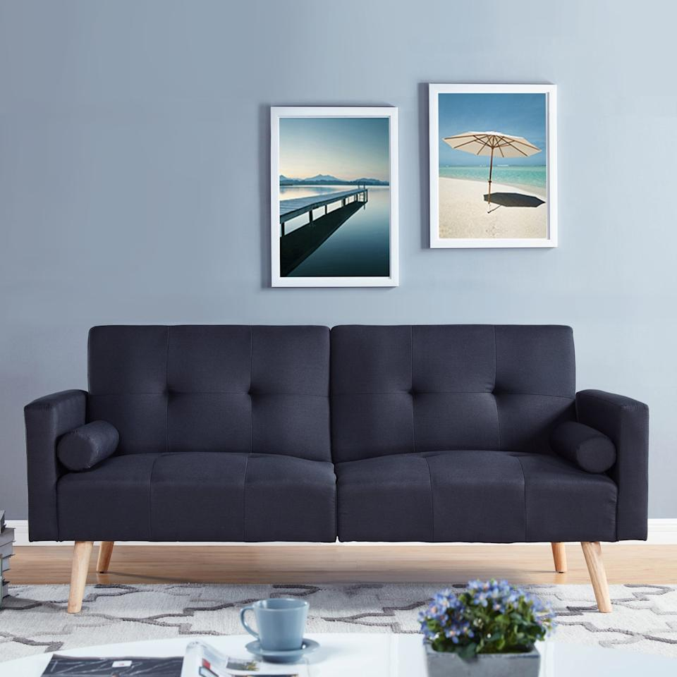 "<p>Simply lay down this <a href=""https://www.popsugar.com/buy/Simmons-Montreal-Upholstered-Convertible-Sofa-415991?p_name=Simmons%20Montreal%20Upholstered%20Convertible%20Sofa&retailer=walmart.com&pid=415991&price=253&evar1=casa%3Aus&evar9=45950398&evar98=https%3A%2F%2Fwww.popsugar.com%2Fphoto-gallery%2F45950398%2Fimage%2F45950404%2FSimmons-Montreal-Upholstered-Convertible-Sofa&list1=home%2Cshopping%2Chome%20decor%2Cfurniture%2Cwalmart%2Chome%20shopping&prop13=api&pdata=1"" rel=""nofollow"" data-shoppable-link=""1"" target=""_blank"" class=""ga-track"" data-ga-category=""Related"" data-ga-label=""https://www.walmart.com/ip/Simmons-Montreal-Upholstered-Convertible-Sofa-Multiple-Colors/755343639"" data-ga-action=""In-Line Links"">Simmons Montreal Upholstered Convertible Sofa</a> ($253), and it turns into a bed.</p>"