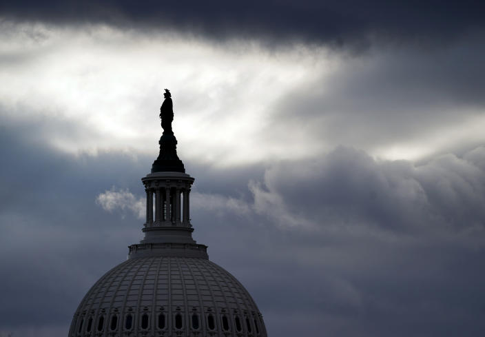 The Statue of Freedom by Thomas Crawford, atop the dome of the U.S. Capitol, is shown ahead of the inauguration of President-elect Joe Biden and Vice President-elect Kamala Harris, Sunday, Jan. 17, 2021, in Washington. (AP Photo/Julio Cortez)