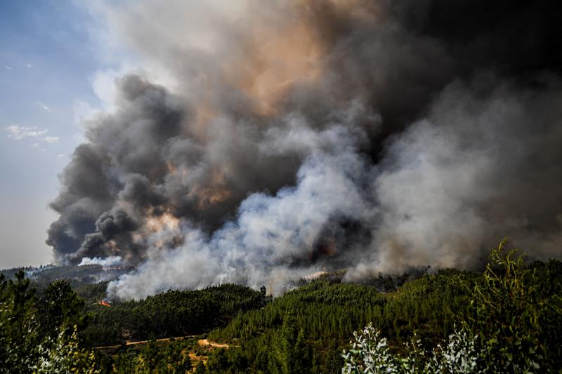 Smoke billows from wildfires in Macao in central Portugal on July 22, 2019. (Photo: Patricia De Melo Moreira/AFP/Getty Images)