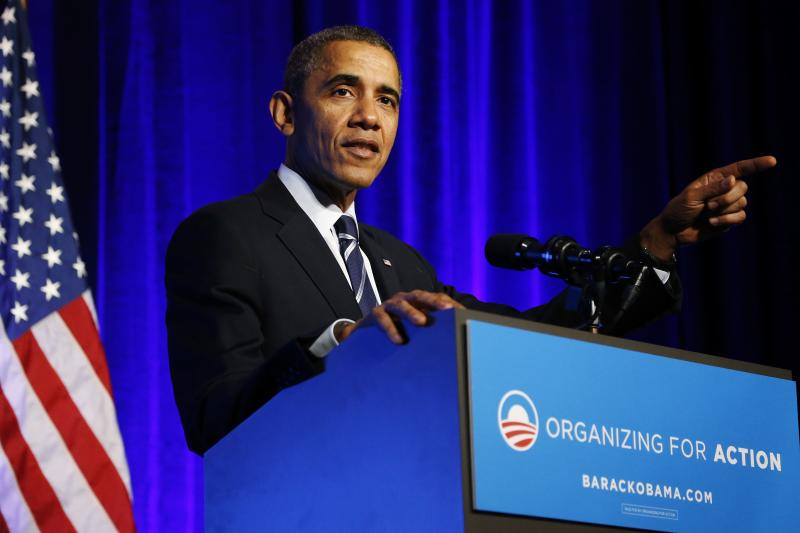 U.S. President Obama gestures as he delivers remarks on Obamacare at an Organizing for Action grassroots supporter event in Washington