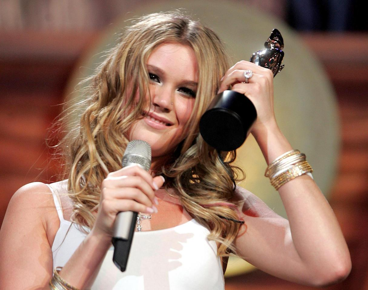 British singer Joss Stone receives her award for Best British Urban Act at the Brit Awards in London, February 9, 2005. REUTERS/Toby Melville  SH/MD