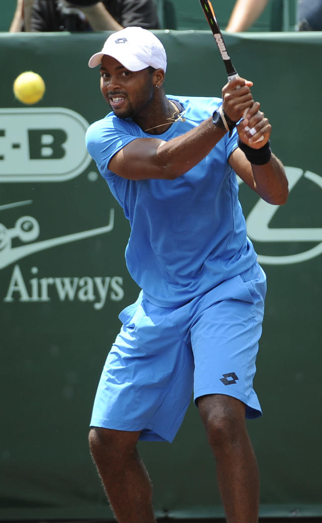 Donald Young returns a shot to Fernando Verdasco, of Spain, in the first set of their quarterfinals match in the U.S. Men's Clay Court Championship Friday, April 11, 2014, in Houston. (AP Photo/Pat Sullivan)