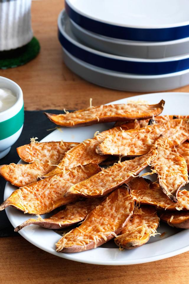 "<p>Give guests a spiced-up twist on the <a rel=""nofollow"" href=""https://www.womansday.com/food-recipes/food-drinks/g1969/sweet-potato-recipes/"">sweet potato side dishes</a> coming their way with these cayenne pepper and cheese-sprinkled skins.</p><p><strong><a rel=""nofollow"" href=""https://www.womansday.com/food-recipes/food-drinks/recipes/a11250/sweet-potato-skins-recipe-122833/"">Get the recipe. </a></strong></p>"