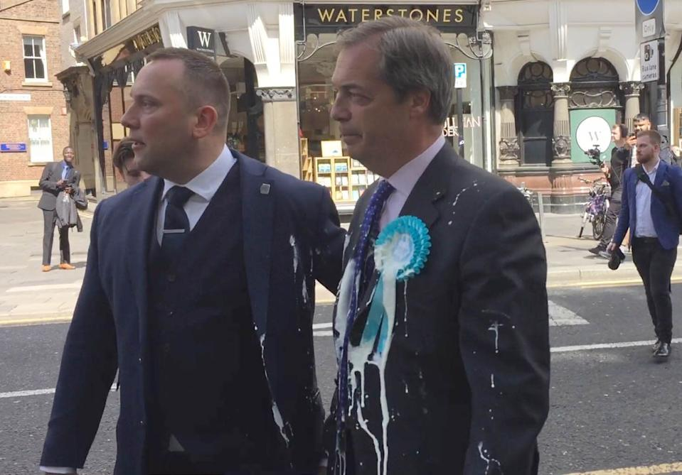 Mr Farage was led away by a security team following the incident (Picture: PA)