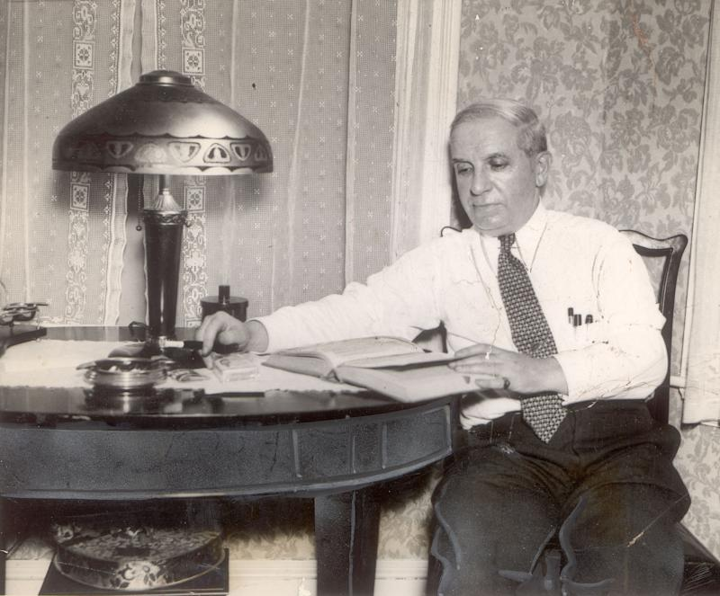 BOSTON, MA - JUNE 22: Charles Ponzi sits at home reading, June 22, 1934, after learning he would be deported back to Italy, his native country. (Photo by The Boston Globe via Getty Images)