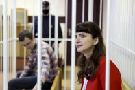Belarusian journalist Katsiaryna Barysevich, right, and Dr. Artom Sorokin attend a court hearing in Minsk, Belarus, Friday, Feb. 19, 2021. Barysevich is accused of revealing personal data in her report on the death of a protester, part of the Belarusian authorities to stifle independent media reports about protests against authoritarian President Alexander Lukashenko.Amnesty International has declared Barysevich and Sorokin prisoners of conscience. (Ramil Nasibulin/BelTA pool photo via AP)