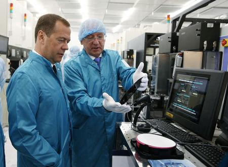 FILE PHOTO: Russian PM Medvedev visits a plant of Russian microchip company Angstrem-T in Zelenograd near Moscow