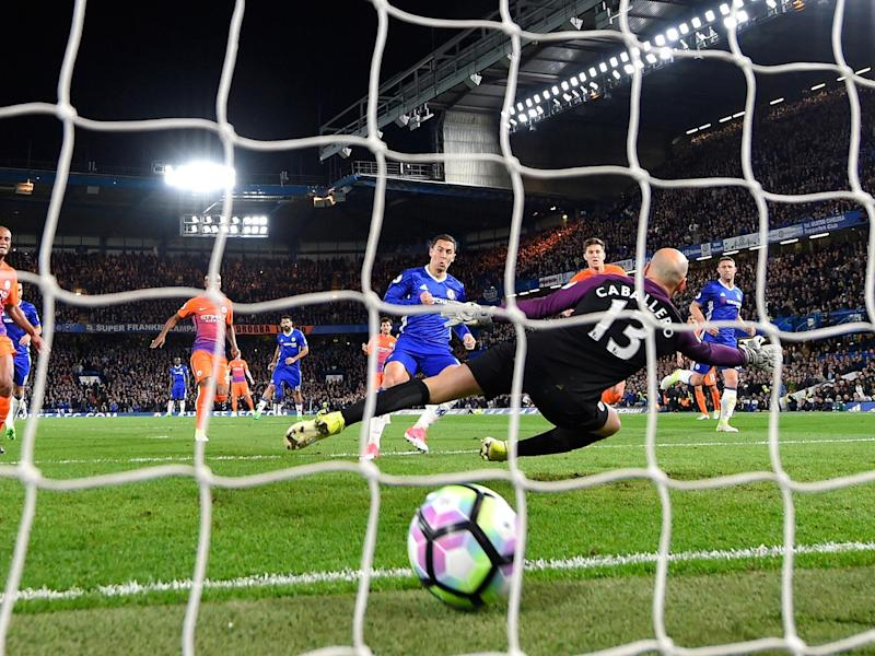 Hazard tucks home the winner after Caballero saved his penalty: Getty