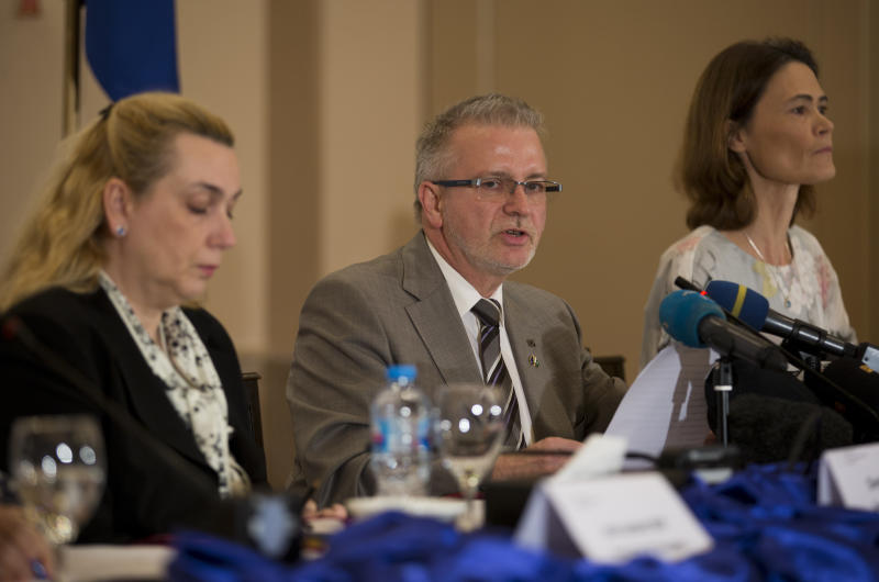 Michael Gahler, center, the European Union's monitoring team chief addresses a news conference in Islamabad, Pakistan, Friday, July 27, 2018. The European Union's monitoring team gave a passing grade to election day polling in Pakistan. But it gave a failing grade to the pre-polling campaigning marred by intimidation of the media and unfair targeting of the former ruling party, which it said overshadowed the successes.(AP Photo/B.K. Bangash)