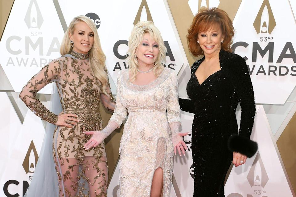 <p>Dolly smiles at the CMAs with Reba McEntire and Carrie Underwood, who both cite Dolly as an inspiration to them. </p>