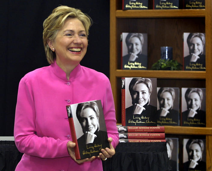 """<p>Sen. Hillary Clinton holds a copy of her book """"Living History"""" prior to a book signing at the Meijers store in Auburn Hills, Mich., in August 2003. (Photo: Bill Pugliano/AP)</p>"""