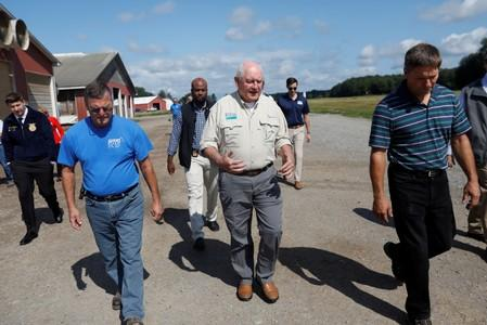 FILE PHOTO: U.S. Agriculture Secretary Sonny Perdue (C) tours the Brabant Farms in Verona, New York