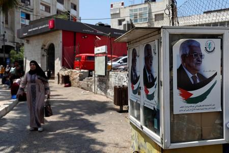 Pictures depicting Palestinian President Mahmoud Abbas are seen in Ramallah, in the Israeli-occupied West Bank