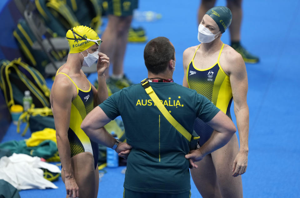 FILE - In this July 21, 2021, file photo, Australia swimmers Bronte Campbell, left, and Cate Campbell waiting to exercise during a swimming training session at the Tokyo Aquatics Centre at the 2020 Summer Olympics in Tokyo, Japan. Campbell was a 17-year-old swimming phenomenon when she learned the dangers of warmup at major competitions the hard way. That's what a head-on collision with Michael Phelps will do for you. (AP Photo/Martin Meissner, File)