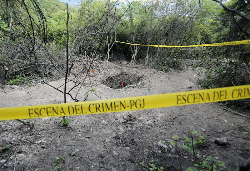 View of a grave in Pueblo Viejo, in the outskirts of Iguala, on October 6, 2014 (AFP Photo/Pedro Pardo)