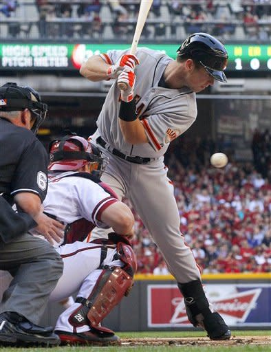 San Francisco Giants' Buster Posey is brushed back by a pitch during the first inning of an opening day baseball game against the Arizona Diamondbacks, Friday, April 6, 2012, in Phoenix. (AP Photo/Matt York)