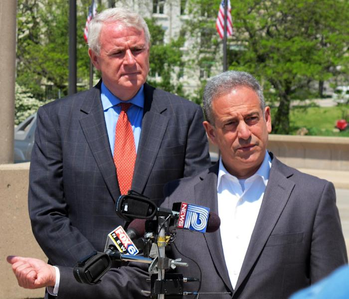 Former Wisconsin U.S. Sen. Russ Feingold, right, campaigns in Milwaukee on Tuesday, May 22, 2012, with Milwaukee Mayor Tom Barrett, the fellow Democrat who will face Republican Gov. Scott Walker in a recall election next month. Feingold says Barrett is honest, ethical and has the Wisconsin values that Walker lacks. (AP Photo/Dinesh Ramde)