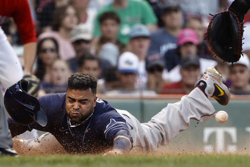 Tampa Bay Rays' Nelson Cruz slides safely home during the 10th inning of a baseball game against the Boston Red Sox, Monday, Sept. 6, 2021, at Fenway Park in Boston. (AP Photo/Winslow Townson)