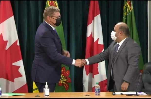 Saskatchewan Premier Scott Moe and Chief Medical Health Officer Dr. Saqib Shahab have not implemented public health measures, mandated vaccines, or made a proof-of-vaccine policy in response to increased cases and hospitalizations in the province. Health officials and doctors have called for provincial intervention. (CBC - image credit)