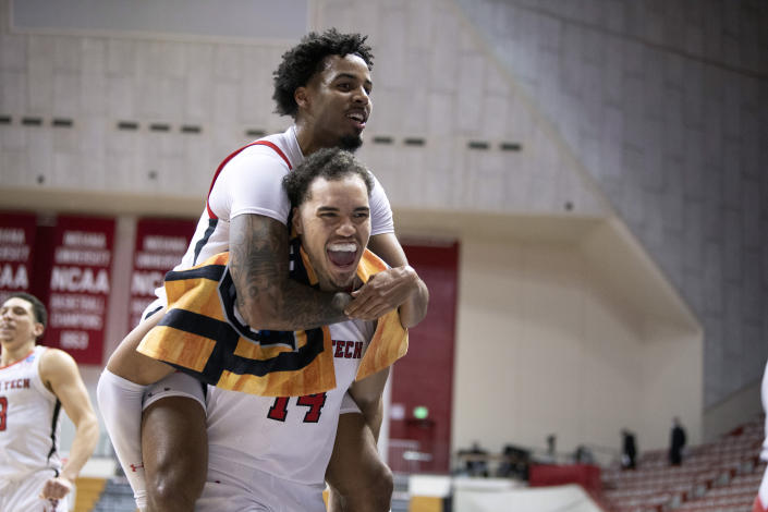 Texas Tech's Kyler Edwards, top, and Marcus Santos-Silva (14) celebrate after a first-round game against Utah State in the NCAA men's college basketball tournament, Friday, March 19, 2021, at Assembly Hall in Bloomington, Ind. (Ben Solomon/Pool Photo via AP)