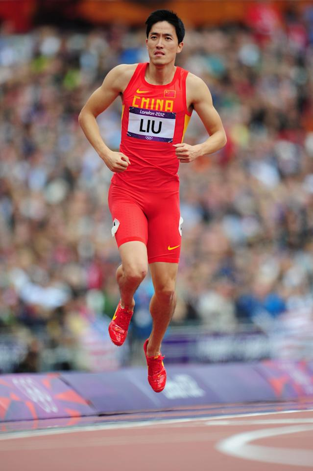 Xiang Liu of China hops on the track after getting injured in the Men's 110m Hurdles Round 1 Heats on Day 11 of the London 2012 Olympic Games at Olympic Stadium on August 7, 2012 in London, England. (Photo by Stu Forster/Getty Images)