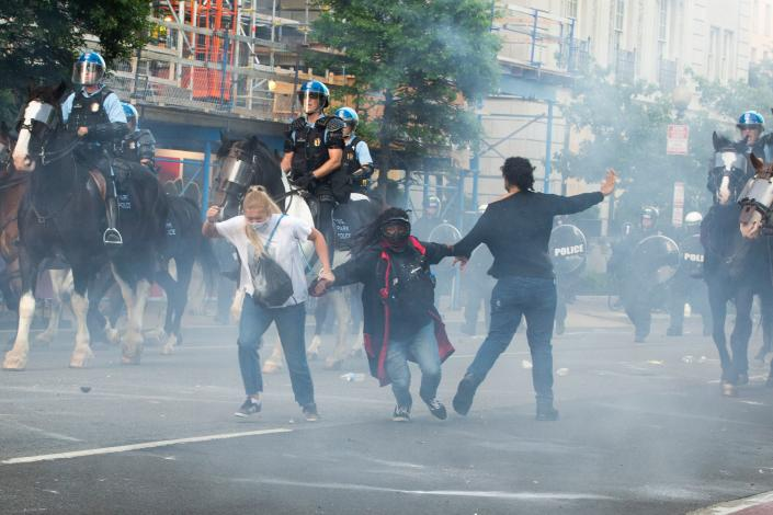 Protesters are teargassed as police disperse them near the White House on June 1. (Roberto Schmidt/AFP via Getty Images)