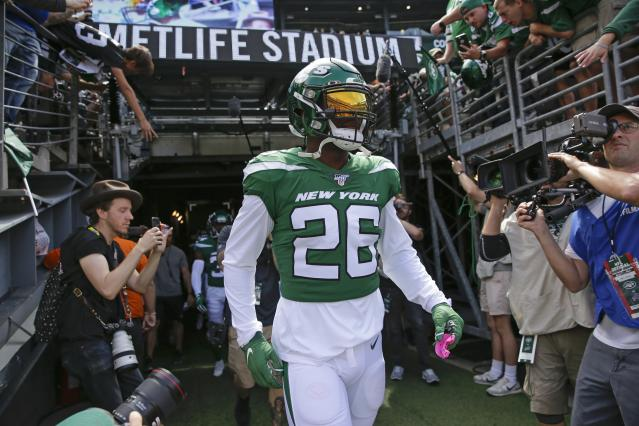 New York Jets running back Le'Veon Bell walks on the field before an NFL football game against the Buffalo Bills Sunday, Sept. 8, 2019, in East Rutherford, N.J. (AP Photo/Seth Wenig)