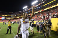 Washington Football Team defensive end Chase Young (99) celebrates after a preseason NFL football game against the Cincinnati Bengals, Friday, Aug. 20, 2021, in Landover, Md. (AP Photo/Nick Wass)