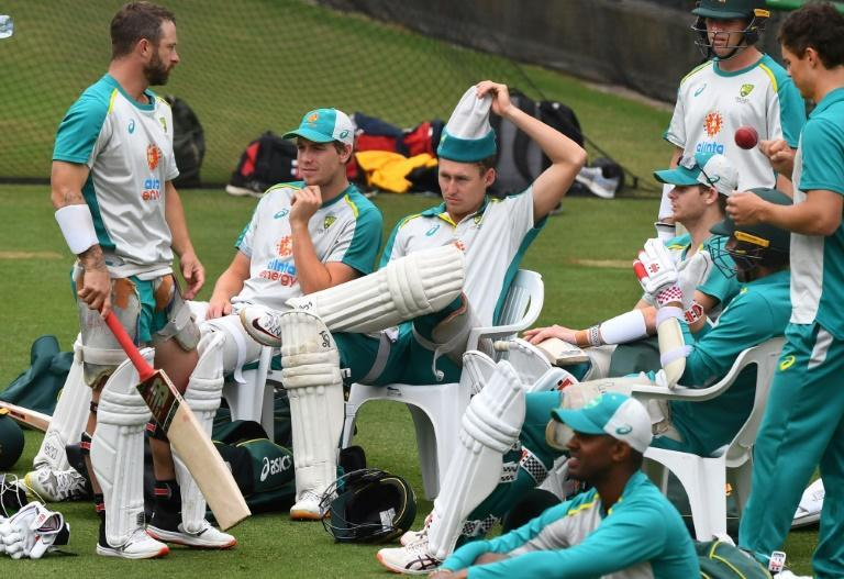 Realaxed: Australia's Marnus Labuschagne pulls off his headgear as his teammates take a break during training at the Melbourne Cricket Ground on December 24
