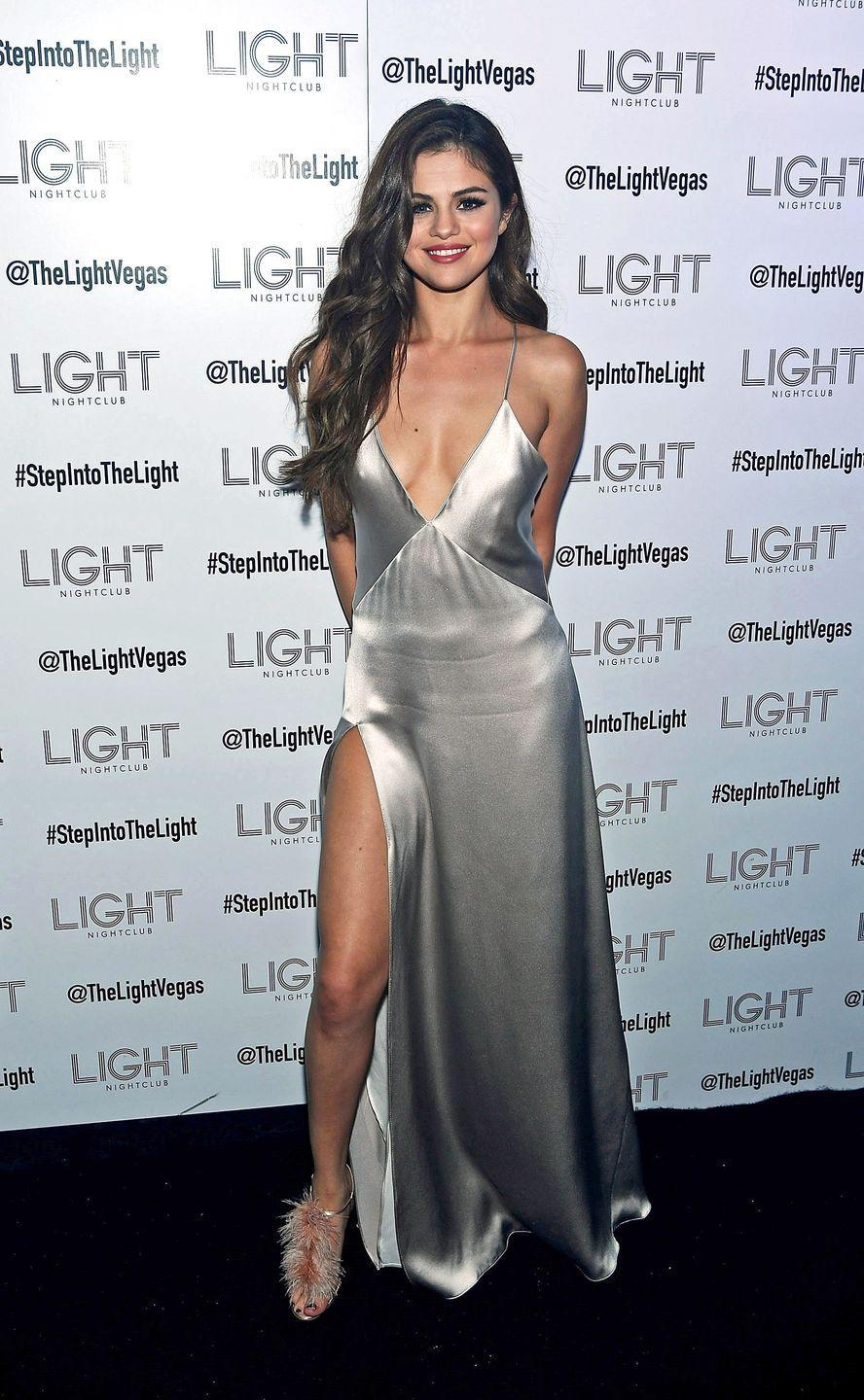 "<p>After kicking off her <a href=""https://www.redbookmag.com/fashion/celebrity-style/g28237/selena-gomez-revival-tour-looks/"" rel=""nofollow noopener"" target=""_blank"" data-ylk=""slk:Revival world tour"" class=""link rapid-noclick-resp"">Revival world tour</a> in Las Vegas, Gomez stepped out in a slinky silver slipdress by Galvan, paired with feathered Manolo Blahnik heels. </p>"