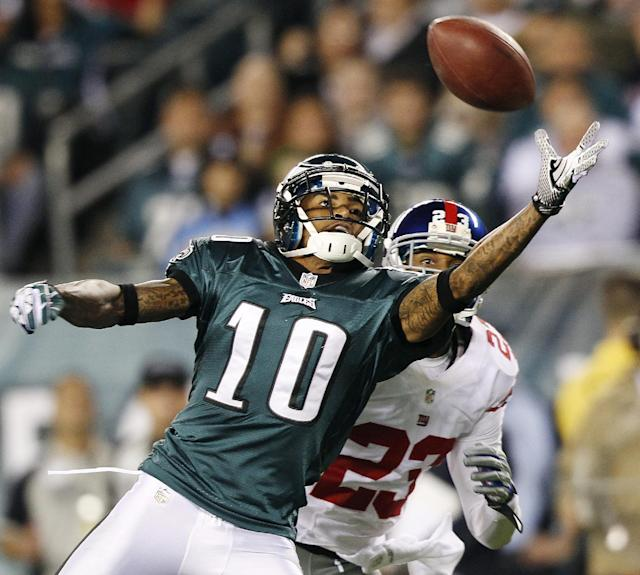 FILE - In this Sept. 30, 2013 file photo, Philadelphia Eagles wide receiver DeSean Jackson (10) reaches for a pass from quarterback Michael Vick as New York Giants cornerback Corey Webster (23) defends during the first half of an NFL football game in Philadelphia. The Eagles have released Jackson. The team cut Jackson on Friday, March 28, 2014. He was coming off a career-best season in Philadelphia, leading the team with 82 catches for 1,332 yards and nine touchdowns.(AP Photo/Mel Evans, File)