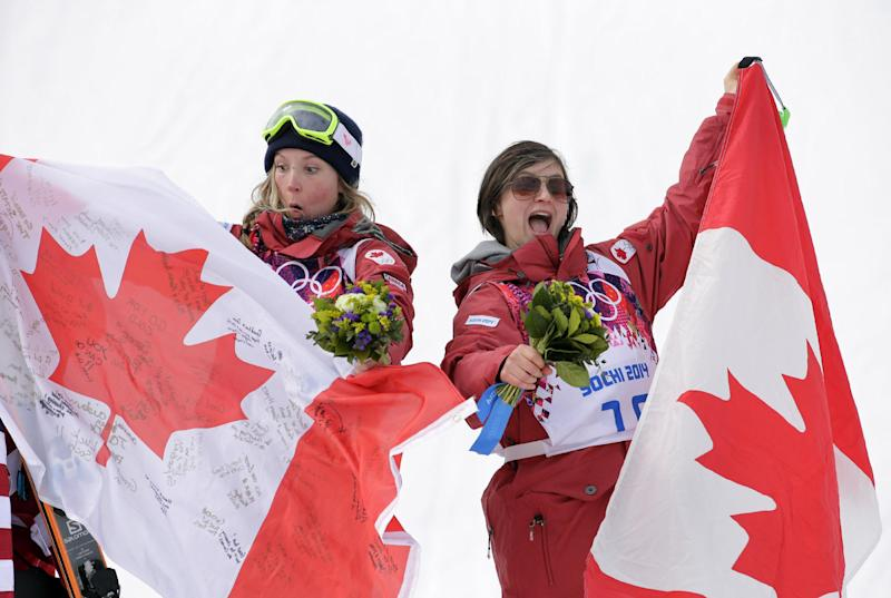 Canada's Dara Howell, left, celebrates with compatriot  Kim Lamarre after Howell took  the gold medal in the women's freestyle skiing slopestyle final at the Rosa Khutor Extreme Park at the 2014 Winter Olympics, Tuesday, Feb. 11, 2014, in Krasnaya Polyana, Russia.  Lamarre took the bronze medal