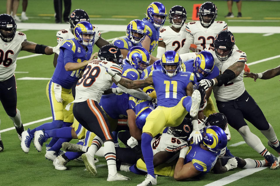Los Angeles Rams players try to push running back Malcolm Brown into the end zone during the second half of an NFL football game against the Chicago Bears Monday, Oct. 26, 2020, in Inglewood, Calif. (AP Photo/Ashley Landis )