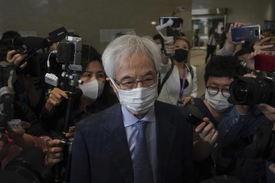 Pro-democracy activist Martin Lee arrives at a court in Hong Kong Friday, April 16, 2021. Seven of Hong Kong's leading pro-democracy advocates, including Lee and pro-democracy media tycoon Jimmy Lai, are expected to be sentenced Friday for organizing a march during the 2019 anti-government protests that triggered an overwhelming crackdown from Beijing.(AP Photo/Kin Cheung)