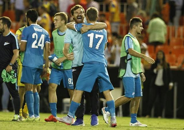 Zenit's coach Andre Villas-Boas (C) celebrates their victoy after the UEFA Champions League group H football match Valencia CF vs FC Zenit at the Mestalla stadium in Valencia on September 16, 2015
