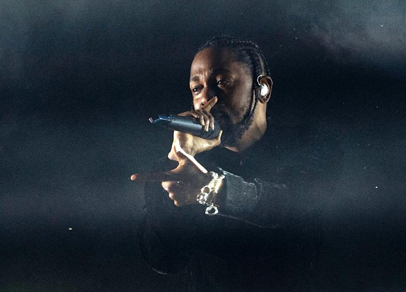 Kendrick Lamar -- shown here in April at Coachella -- is up for seven Grammys (AFP Photo/VALERIE MACON)