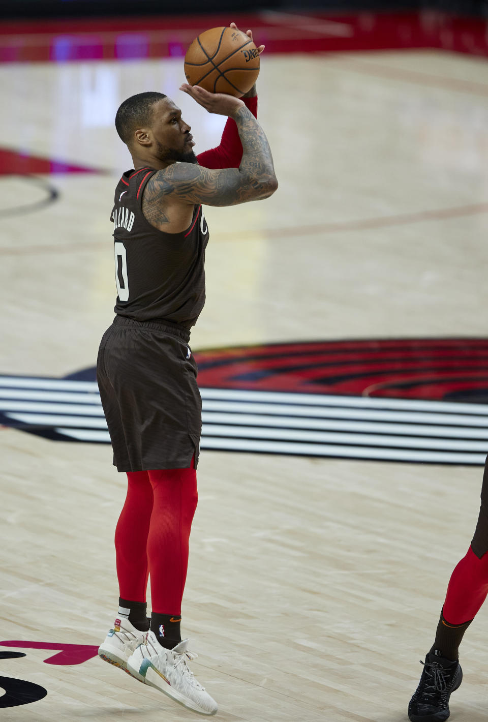 Portland Trail Blazers guard Damian Lillard shoots a 3-pointer against the Golden State Warriors during the second half of an NBA basketball game in Portland, Ore., Wednesday, March 3, 2021. (AP Photo/Craig Mitchelldyer)