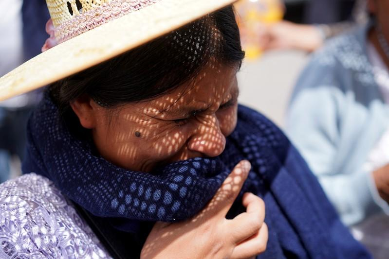 A woman mourns during the funeral of her relative and supporter of former Bolivian President Morales in Cochabamba