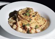 """Fragrant lemon pasta meets pillowy scallops in this Amalfi-inspired rendition. <a href=""""https://www.bonappetit.com/recipe/taglierini-with-bay-scallops-and-meyer-lemon?mbid=synd_yahoo_rss"""" rel=""""nofollow noopener"""" target=""""_blank"""" data-ylk=""""slk:See recipe."""" class=""""link rapid-noclick-resp"""">See recipe.</a>"""