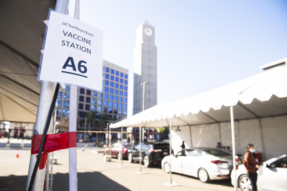 Healthcare workers wait to receive their COVID-19 vaccine in the tailgate lot of PETCO Park. (Photo by Matt Thomas/San Diego Padres/Getty Images)