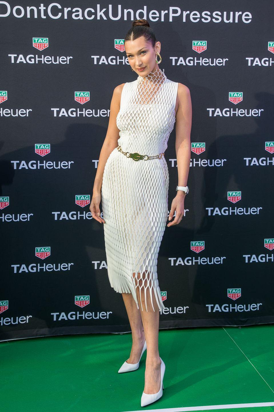 <p>Hadid attended a Tag Heuer party during the Monaco Grand Prix wearing a white netted halter-neck dress and matching stilletos, May 2018.</p>