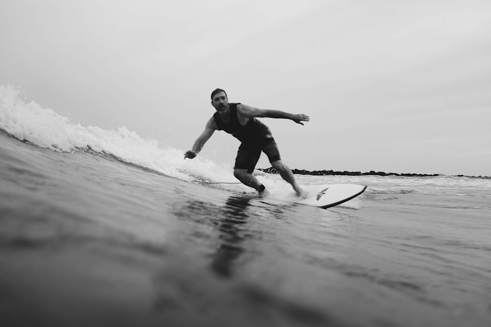 Bryson Corso catches a wave between rock jetties in Grand Isle
