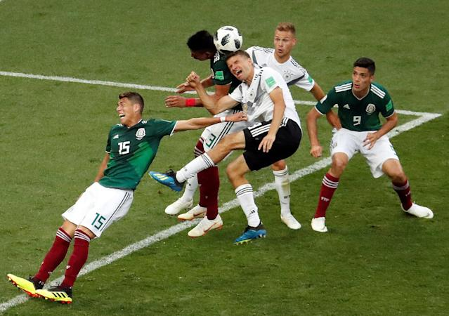 Soccer Football - World Cup - Group F - Germany vs Mexico - Luzhniki Stadium, Moscow, Russia - June 17, 2018 Germany's Thomas Muller and Joshua Kimmich in action with Mexico's Hector Moreno, Raul Jimenez and Jesus Gallardo REUTERS/Christian Hartmann TPX IMAGES OF THE DAY