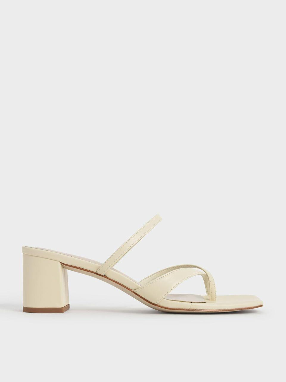 """<p><strong>Charles & Keith </strong></p><p>charleskeith.com</p><p><strong>$46.00</strong></p><p><a href=""""https://go.redirectingat.com?id=74968X1596630&url=https%3A%2F%2Fwww.charleskeith.com%2Fus%2Fshoes%2FCK1-60050932_CHALK.html&sref=https%3A%2F%2Fwww.marieclaire.com%2Ffashion%2Fg27205502%2Fcomfortable-walking-sandals-women%2F"""" rel=""""nofollow noopener"""" target=""""_blank"""" data-ylk=""""slk:SHOP IT"""" class=""""link rapid-noclick-resp"""">SHOP IT</a></p><p>Wearing bright colors seems fun and all, but this pair of strappy white shoes from Charles & Keith will go with literally every single item in your closet. The toe loop and low block heel make them perfect for all-day wear. </p>"""