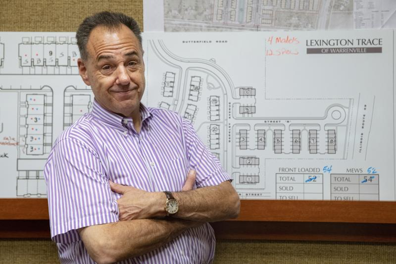In this Tuesday, July 16, 2019 photo, Jeff Benach, co-owner of Lexington Homes poses for a portrait inside his office in Chicago. Lexington Homes, which has townhouse and single-family developments in the Chicago area, has been building smaller projects than in the past, Benach says. (AP Photo/Amr Alfiky)