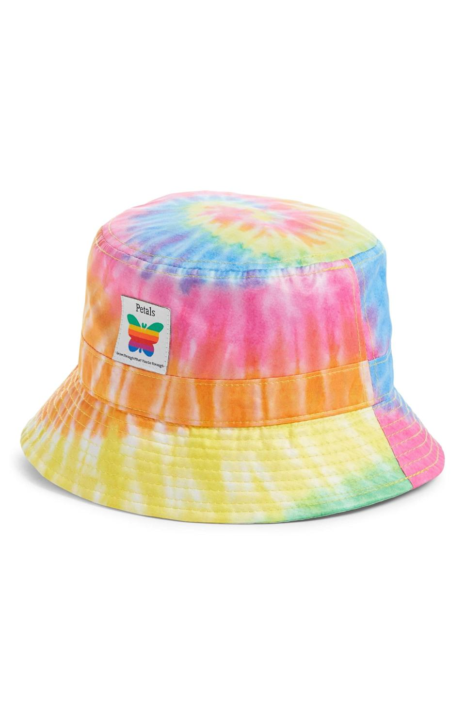 <p>This flamboyant <span>Peatals and Peacocks Tie Dye Bucket Hat</span> ($28) will add a touch of playful confidence to any look.</p>