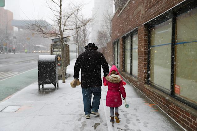 <p>A man walks his daughter to school in New York City as a winter storm moved into the area on Wednesday, March 21, 2018. (Photo: Gordon Donovan/Yahoo News) </p>
