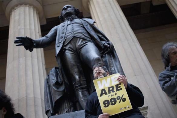 "An Occupy Wall Street protestor stands on the steps of Federal Hall in the financial district in New York March 30, 2012. According to organizers, the focus of the day was ""spring training,"" and included teaching people how to lead a march, handle law enforcement and resist arrest."